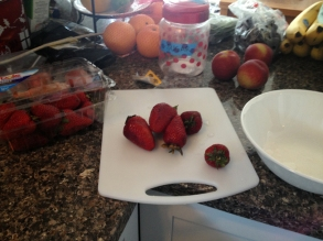 Cutting up those berries.