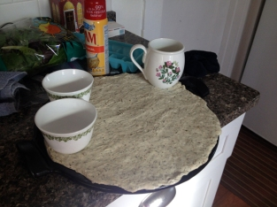 Stretching the dough over the stone.